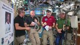 ISS astronauts show off their pre-packaged Thanksgiving meal
