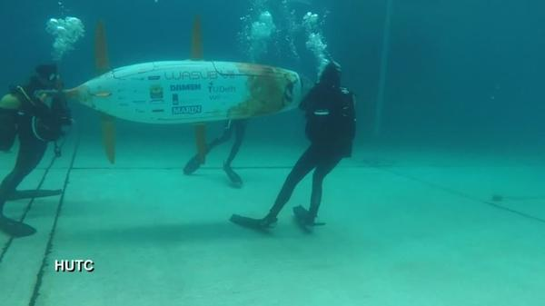 Human-powered submarines race it out in UK pool