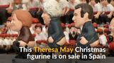 Theresa May joins 'pooper' party as Christmas figurine