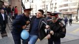 Kazakh police detain dozens at opposition rallies after president quits