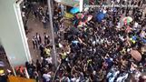 Police, protesters scuffle at Hong Kong border town