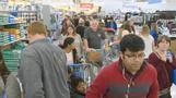 Walmart hikes earnings outlook, reopens El Paso store