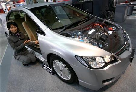 An Exhibitor Displays Honda S Civic Hybrid Mx At Exhibition Of The International Battery And Fuel Cell Electric Vehicle Symposium Exposition In