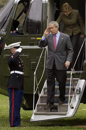 U.S. President George W. Bush (C) salutes as he and first lady Laura Bush return via helicopter from a visit at Camp David to the White House in Washington April 1, 2007. Bush's administration has crippled al Qaeda's ability to carry out major attacks on U.S. soil but at a political and economic cost that could leave the country more vulnerable in years to come, experts say. REUTERS/Jonathan Ernst