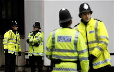 Police stand guard outside Westminster Magistrates Court in London as a van arrives containing a prisoner charged under the terrorism act, in this February 10, 2007 file photo. The European Union agreed on Monday to inform groups and people why they are put on its list of terrorist organizations, a move aimed at avoiding decisions being overturned in court. REUTERS/Alessia Pierdomenico
