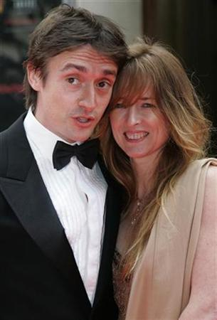Presenter Richard Hammond with wife Amanda arrives for British Academy Television Awards at the Palladium theatre in London May 20, 2007. REUTERS/Luke MacGregor