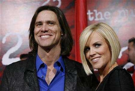 Actor Jim Carrey and girlfriend Jenny McCarthy pose for photographers during the premiere of ''The Number 23'' in Los Angeles, in this file photo from February 13, 2007. In a new big-screen version of Charles Dickiens' ''A Christmas Carol,'' Carrey will play Scrooge, the Ghost of Christmas Past, the Ghost of Christmas Present and the Ghost of Christmas Future. REUTERS/Gus Ruelas