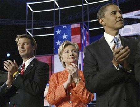 Democratic presidential candidates (L-R) former U.S. Senator John Edwards (D-NC), U.S. Senator Hillary Clinton (D-NY) and U.S. Senator Barack Obama (D-IL) applaud at the start of their CNN/YouTube debate in Charleston, South Carolina on the campus of The Citadel, July 23, 2007. The three top Democratic presidential candidates are virtually tied in a new poll in Iowa, where voters will kick off the presidential nominating process in six months, The Washington Post reported in its Friday edition. REUTERS/Chris Keane