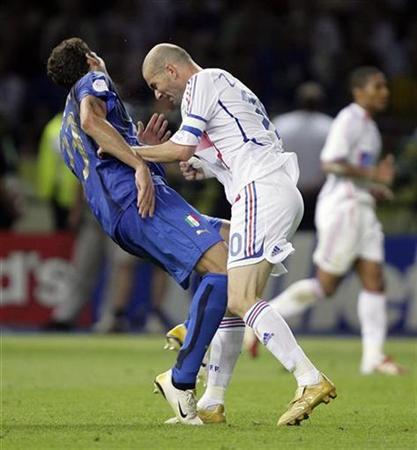 Italy's Marco Materazzi falls on the pitch after being head-butted by France's Zinedine Zidane (R) during their World Cup 2006 final football match in Berlin July 9, 2006. Picture taken July 9, 2006. REUTERS/Peter Schols/GPD/Handout