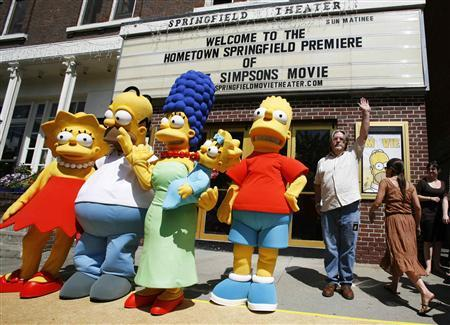 Creator of the show ''The Simpsons'' creator Matt Groening (R) waves alongside characters (L-R) Lisa, Homer, Marge, Maggie, and Bart Simpson as he arrives for the premiere of the film ''The Simpsons Movie'' in Springfield, Vermont July 21, 2007. Australia has the dubious distinction of being the first country in the world where ''The Simpsons Movie'' was pirated, with an illegal Internet copy of the worldwide hit traced to a man who allegedly used his cell phone to record the movie at a cinema. REUTERS/Lucas Jackson