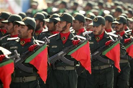 Members of Iran's Revolutionary Guard parade during a ceremony to mark war day in Tehran September 22, 2006. Iran's Islamic Revolutionary Guards are using front groups to beat U.N. sanctions and acquire weapons and material for Tehran's nuclear program, an exiled opponent of the Iranian government said on Wednesday. REUTERS/Morteza Nikoubazl