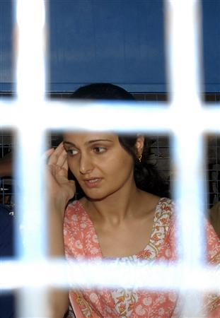 Former Bollywood actress Monica Bedi arrives at a railway station in the southern Indian city of Hyderabad July 18, 2007. India's Supreme Court barred the media on Friday from showing nude photographs of Bedi , said to have been taken by a camera hidden in the bathroom of the jail where she was imprisoned over a forgery case. REUTERS/Krishnendu Halder