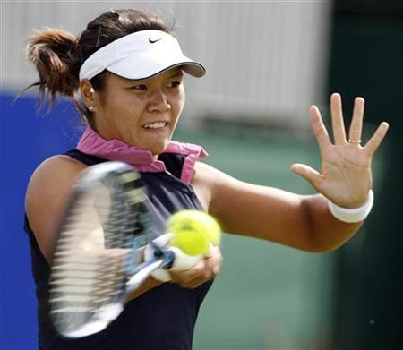 In this file photo China's Li Na returns a shot to Yaroslava Shvedova of Russia during their match at the Birmingham Classic tennis tournament in Birmingham, central England, June 12, 2007. REUTERS/Darren Staples