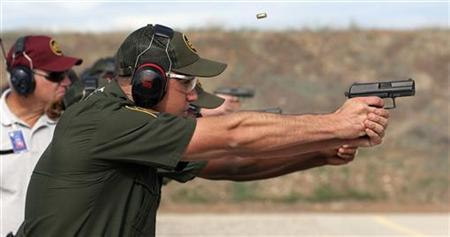 A trainee fires his Heckler & Koch .40 caliber P2000 handgun during a class session on the firing range at the U.S. Border Patrol Training Academy in Artesia, New Mexico, August 17, 2006. A case challenging the ban on private handgun ownership in the U.S. capital could lead to the first ruling by the Supreme Court since 1939 on the rights of Americans to bear arms. REUTERS/Jeff Topping
