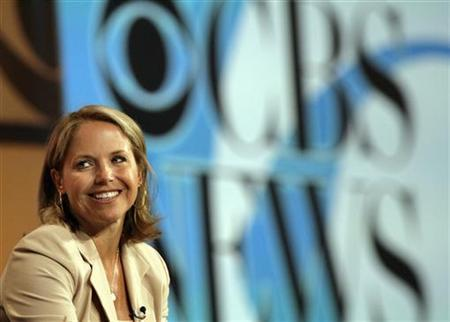 News anchor Katie Couric smiles during a CBS News panel at the ''Television Critics Association'' summer 2006 media tour in Pasadena, California, July 16, 2006. REUTERS/Mario Anzuoni