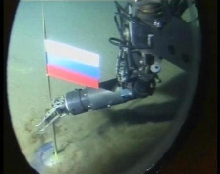 A video grab shows the view out of the porthole of a Russian miniature submarine as its robotic arm plants the Russian flag on the seabed 14,000 feet below the North Pole August 2, 2007. Samples of earth taken by Russians who planted a flag on the seabed below the North Pole last month show beyond doubt the Arctic is Russian, its natural resources ministry said on Thursday. REUTERS/Reuters TV