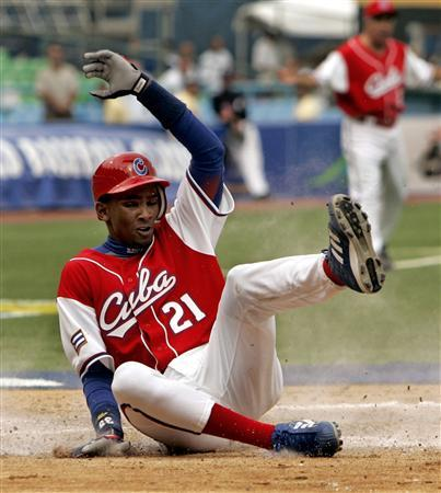 Alexei Ramirez of Cuba scores in the seventh inning against Panama during their World Baseball Classic game in San Juan, Puerto Rico, in this file photo taken March 8, 2006. REUTERS/Robert Galbraith/Files
