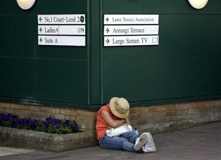 A spectator finds a place to sleep at the Wimbledon tennis championships in London July 1, 2006. People who do not get enough sleep are more than twice as likely to die of heart disease, according to a study released on Monday. REUTERS/Darren Staples