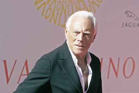 Fashion designer Giorgio Armani poses for photographers as he walks the red  carpet at the entry cf244300258