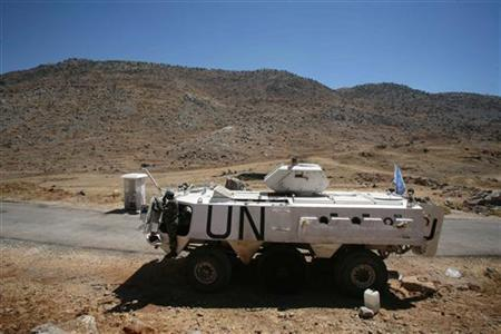 A U.N. armoured personnel carrier patrols in the disputed Shebaa Farms area as seen from south Lebanon August 31, 2006. Syria has indicated it is willing to allow the United Nations to take custody of the disputed Shebaa Farms area claimed by Lebanon but which is under Israeli occupation, a Spanish diplomat said on Wednesday. REUTERS/Ammar Awad