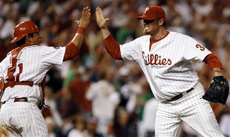Philadelphia Phillies pitcher Brett Myers (R) celebrates a win over the Atlanta Braves with Phillies catcher Carlos Ruiz after the ninth inning of their MLB National League baseball game in Philadelphia, Pennsylvania, September 27, 2007. REUTERS/Tim Shaffer