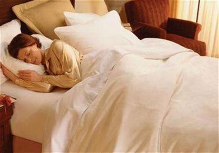 A woman sleeps in an undated photo. A German scientist has come up with a solution for snoring -- a computerized pillow that shifts the head's sleeping position until the noise stops. REUTERS/PRNewsFoto