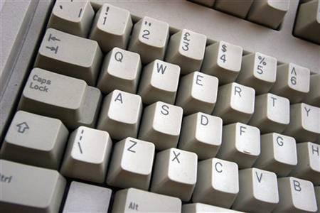 A generic picture of a computer keyboard. An international crackdown on Internet financial scams this year has yielded more than $2.1 billion in seized fake checks and 77 arrests in the Netherlands, Nigeria and Canada, U.S. and other authorities said on Wednesday. REUTERS/Catherine Benson
