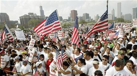 People gather for an immigration rally in downtown Chicago, May 1, 2007. A U.S. federal court judge on Wednesday granted a preliminary injunction barring the Bush administration from going ahead with a controversial program to remove illegal immigrants from the U.S. work force. REUTERS/Frank Polich
