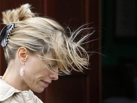 Kate McCann, the mother of missing girl Madeleine McCann, leaves the Catholic Church of Sacred Heart in Rothley September 23, 2007. Madeleine's parents repaid two instalments of their mortgage with money from the fund set up to help find her, their spokesman confirmed on Tuesday. REUTERS/Darren Staples