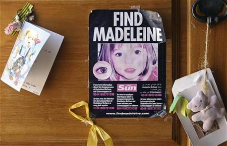 A poster of missing Madeleine McCann is displayed on the church door of Praia da Luz beach resort in the southern Portuguese province of Algarve August 7, 2007. REUTERS/Virgilio Rodrigues
