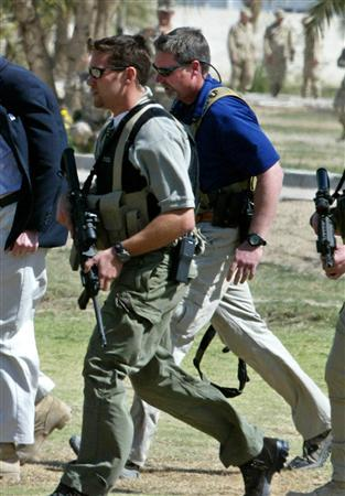 Personnel from U.S. security contractor Blackwater are seen at U.S. Army 82nd Airborne Division headquarters in Ramadi in this March 11, 2004 file photo. Private security companies operate without supervision or accountability in war zones, including Iraq and Afghanistan, and represent a new form of mercenary activity, a United Nations report said on Tuesday. Private U.S. security firms have come under scrutiny since a shooting in September in which Blackwater guards working for the State Department were accused of killing 17 Iraqis in Baghdad. REUTERS/Peter Andrews/Files
