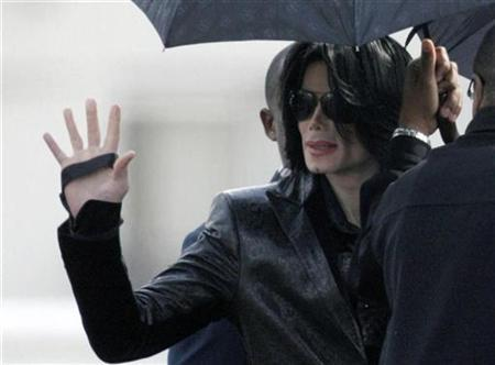 U.S. pop star Michael Jackson waves to fans at a U.S. military facility in Tokyo, as he walks to board a helicopter bound for Camp Zama, a U.S. military base west of Tokyo, to join a fan appreciation event March 10, 2007. After years of silence, rumor and a sordid trial, Jackson has given his first major U.S. interview in a decade -- and has been pronounced normal. REUTERS/Kim Kyung-Hoon