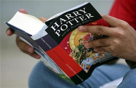 A fan reads ''Harry Potter and the Deathly Hallows'' in the Indian city of Ahmedabad, July 21, 2007. Nearly 80 percent of Britons have re-read a book, with the Harry Potter series the most likely to be picked up again, a survey revealed on Friday. REUTERS/Amit Dave