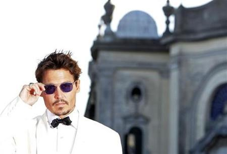 Johnny Depp arrives at the Cimena Palace in Venice September 05, 2007. REUTERS/Stefano Rellandini