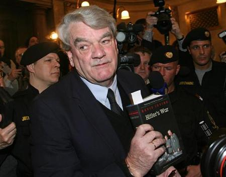 File picture shows historian David Irving, then facing charges of Holocaust denial in an Austrian court, as he talks to reporters in the courtroom February 20, 2006. The head of the Equality and Human Rights Commission asked Oxford University's debating society on Sunday to review its decision to invite Irving to speak at a free speech forum. REUTERS/Heinz-Peter Bader