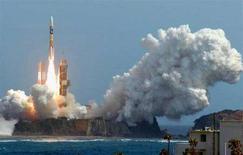 <p>Un'immagine del lancio del razzo che trasportava la navicella lunare. REUTERS/KYODO Kyodo</p>