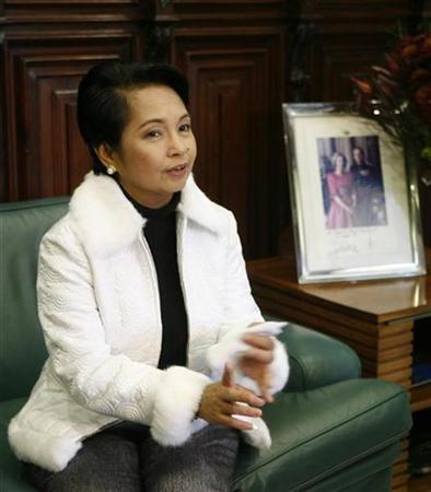 Philippine's President Gloria Macapagal Arroyo talks during a metting with Andalusia's regional government president Manuel Chaves in Seville December 7, 2007. President Gloria Macapagal Arroyo is considered the most corrupt Philippine leader in history, more than Ferdinand Marcos and Joseph Estrada, who were ousted from office, according to an opinion poll published on Wednesday. REUTERS/Marcelo del Pozo