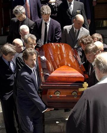 The coffin containing Paul Klebnikov, editor of Forbes Magazine's Russia edition, is carried out of St. Nicholas Russian Orthodox church in New York July 16, 2004, after his funeral. A Russian court on Monday halted the retrial of three men accused of the 2004 murder of U.S. journalist Paul Klebnikov, because one of the defendants was still at large, court officials and a defense lawyer said. REUTERS/Chip East