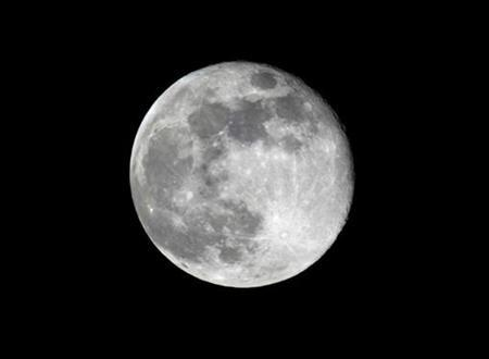 A full moon rises over Washington, December 5, 2006. nternet searches for lunar land prices show the cost of buying an acre of the moon's surface has risen 40 percent since the start of 2007, investment bank UBS told clients in a tongue-in-cheek analysis. REUTERS/Larry Downing