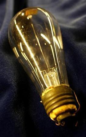 An Edison electric light bulb is displayed at Christie's auction house in London December 8, 2006. The light bulb Thomas Edison invented 125 years ago is getting more than a make-over. The government is pulling the plug on it. REUTERS/Dylan Martinez