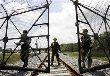 South Korean soldiers open a gate for a North Korean train at the demilitarized zone (DMZ) in Goseong, east of Seoul May 17, 2007. REUTERS/Ahn Young-joon/Pool