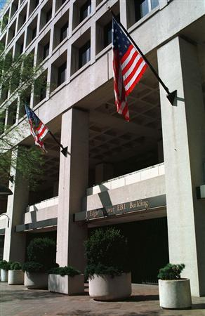 The J. Edgar Hoover FBI building in Washington is seen in an undated file photo. A telephone company cut off an FBI international wiretap after the agency failed to pay its bill on time, according to a government audit released on Thursday. REUTERS/File
