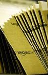 <p>Le kiosque de musique numérique d'Amazon.com va proposer des titres de Sony BMG Music Entertainment dépourvus de dispositifs DRM (digital rights management) destinés à assurer une protection anti-copie. /Photo d'archives/REUTERS/Dylan Martinez</p>