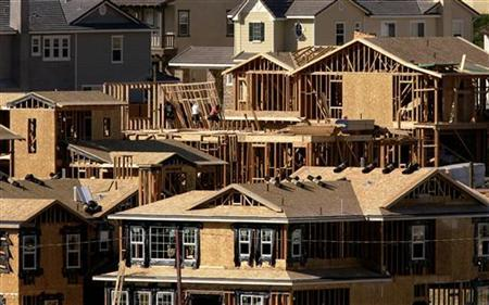 Construction workers put up second story framing as they build homes in Carlsbad, California November 17, 2005. REUTERS/Mike Blake