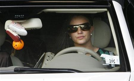 Britney Spears drives her Mercedes Benz as she leaves the Stanley Mosk Courthouse garage after a child custody hearing with her ex-husband regarding her two sons in Los Angeles, California October 26, 2007. Despite Spears' erratic behavior, most people think the troubled pop star should be allowed to see her two sons a few times a week under supervision while ex-husband Kevin Federline retains custody, according to an E-Poll/Reuters survey. REUTERS/Fred Prouser