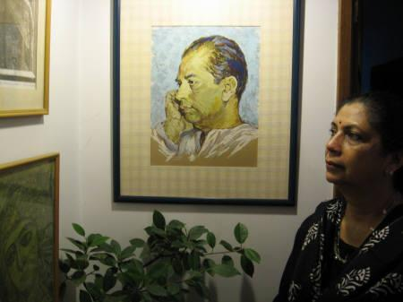 Rinki Bhattacharya stands beside a framed portrait of her father, filmmaker Bimal Roy, at her Mumbai residence February 7, 2008. Four decades after his death, Roy's stature as one of India's foremost filmmakers is on the decline, thanks to a new generation of cinema goers who have never watched his films. REUTERS/Prithwish Ganguly