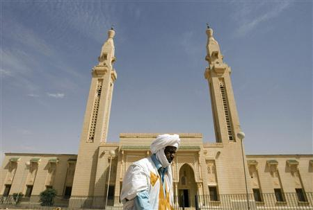 A man walks in front of the Saudi Mosque in central Nouakchott, February 2, 2008. Growing Al Qaeda presence in the Islamic Republic of Mauritania raises diplomatic and political concerns about security in Mauritania following three Al Qaeda attacks since December 2007. REUTERS/Normand Blouin