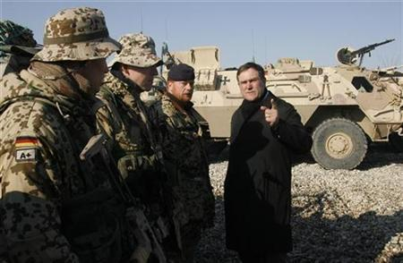 Germany's Defence Minister Franz-Josef Jung talks to German ISAF soldiers during his visit to camp Marmmal at the German ISAF headquarters in Masar-i-Sharif north of the Afghanistan capital Kabul Januar 30, 2008. REUTERS/Fabrizio Bensch