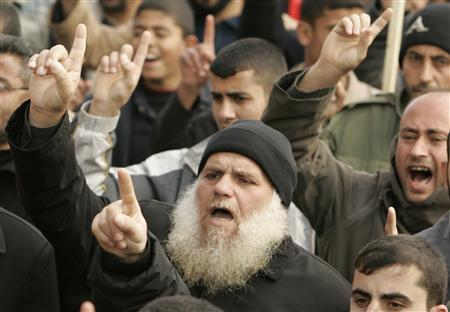 Palestinians shout slogans during a protest organized by the Hamas movement against a drawing of the Prophet Mohammad republished by five major daily newspapers in Denmark which angered Muslims around the world when it was originally published in September 2005, in the northern Gaza Strip, February 15, 2008. REUTERS/Mohammed Salem
