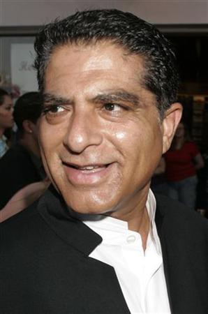 Self-help author Deepak Chopra arrives for the premiere of her new film ''Cinderella Man'' at Universal CityWalk in Los Angeles, May 23, 2005. REUTERS/Fred Prouser